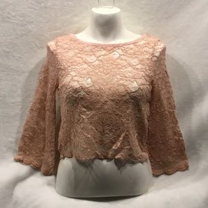Pink lace crop top with crystal button detail